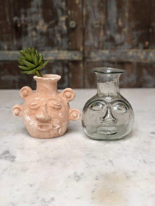 incas head shaped vases in terracotta or transparent glass