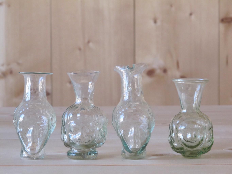 L to R: Johnas sans anse, Thibaut, Johnas avec anse, Chiara head-shaped handblown glass vases by La Soufflerie