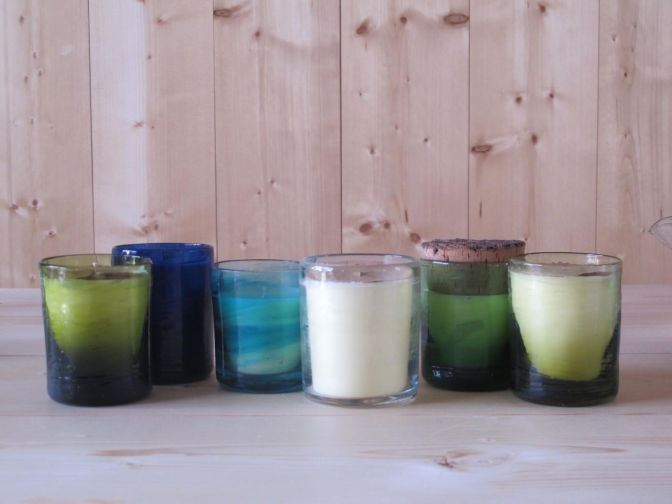 L to R: Murano Moyen Bougie Olive, Blue, Turquoise, Transparent, Green with cork lid, Honey