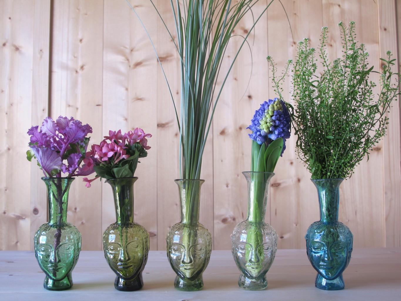 L to R: Vase Tete Green, Olive, Yellow, Transparent, Turquoise