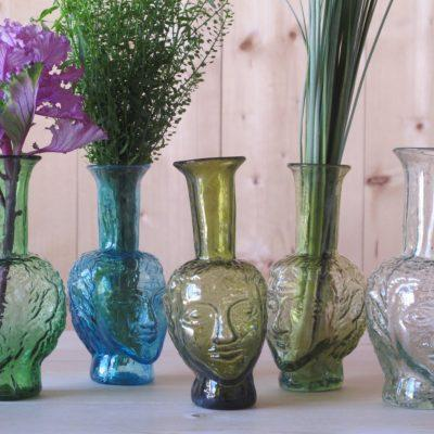 L to R: Vase Tete Green, Turquoise, Olive, Yellow, Transparent