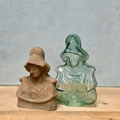 jess with hat sculptures in terracotta and transparent glass