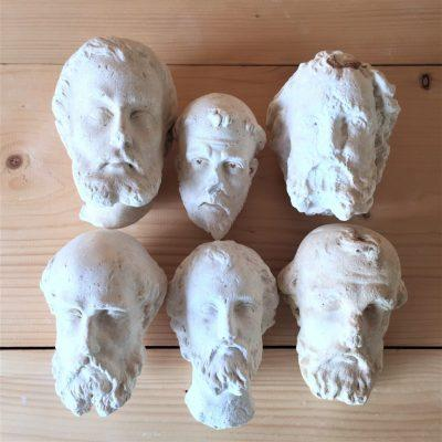 Monk-heads-head-shaped-plaster-sculptures