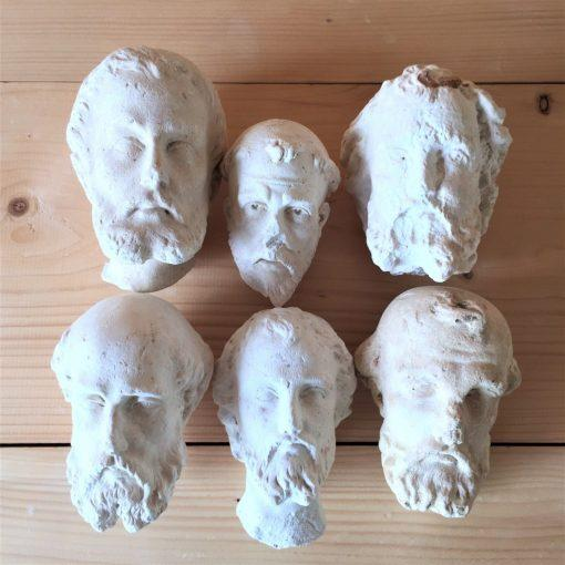Monk heads head shaped plaster sculptures