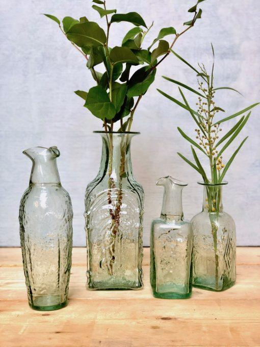 la-soufflerie-antichita-dates-menora-carafes-vases-bas-relief-transparent-hand-blown-recycled-glass