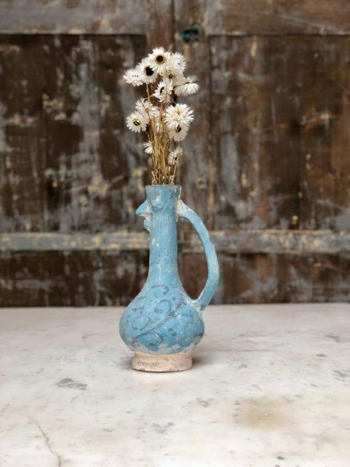 la poule terracotta vase painted blue shaped like a chicken